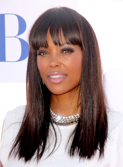 Aisha Tyler's Straight, Brunette, Sophisticated Hairstyle with Bangs