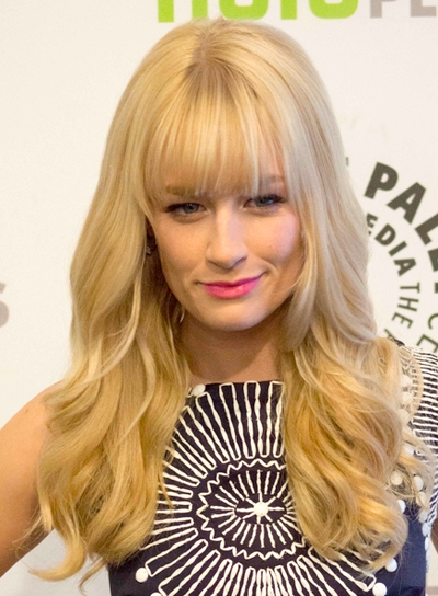 Beth Behrs' Long, Blonde, Wavy Hairstyle with Bangs