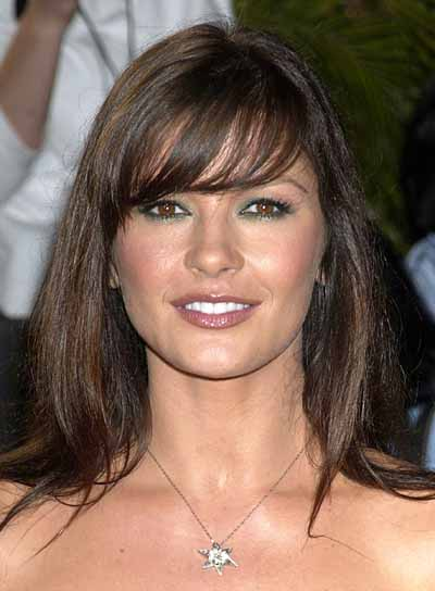 Catherine Zeta-Jones Medium Hairstyle with Bangs
