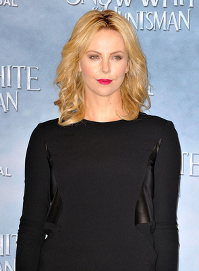 Charlize Theron's Wavy, Chic, Blonde, Medium Hairstyle