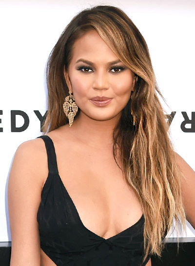 Chrissy Teigen with a Long, Wavy, Brunette, Sexy Hairstyle Pictures