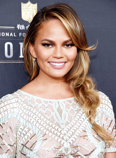 Chrissy Teigen with a Long, Blonde, Funky, Hairstyle with Braids and Twists Pictures