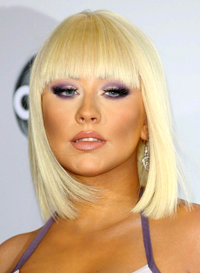Christina Aguilera's Chic, Medium, Blonde, Hairstyle with Bangs