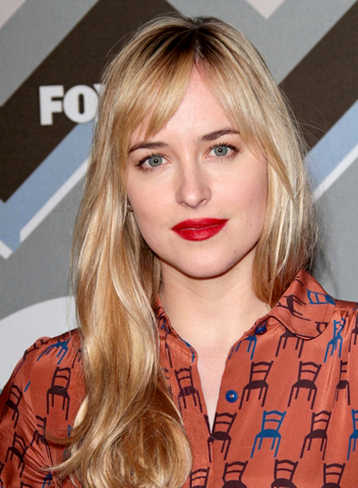 Dakota Johnson's Long, Wavy, Blonde Hairstyle with Bangs