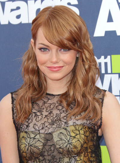 Emma Stone Wavy Romantic Red Hairstyle With Bangs